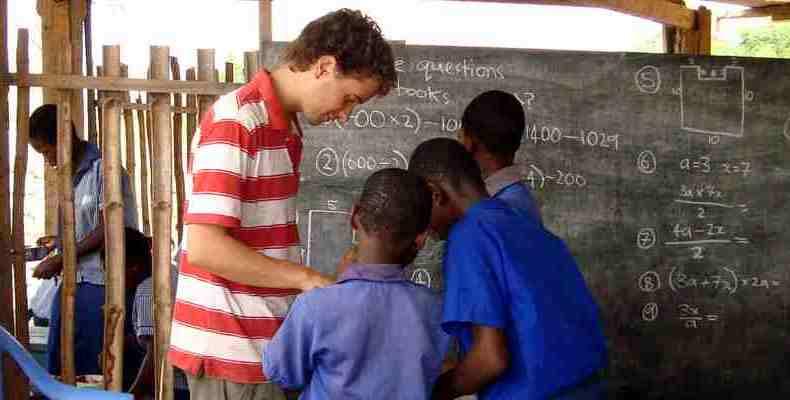 Volunteer math teacher in village school, Ghana Africa. Volunteer with sightseeing in Ghana